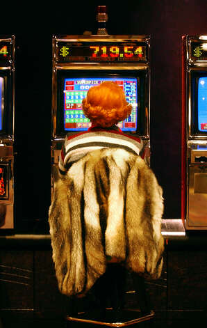 A woman plays the slots at Turning Stone Casino in Verona , New York. (Michael  P. Farrell / Times Union Archive) Photo: MICHAEL P. FARRELL, DG / TIMES UNION
