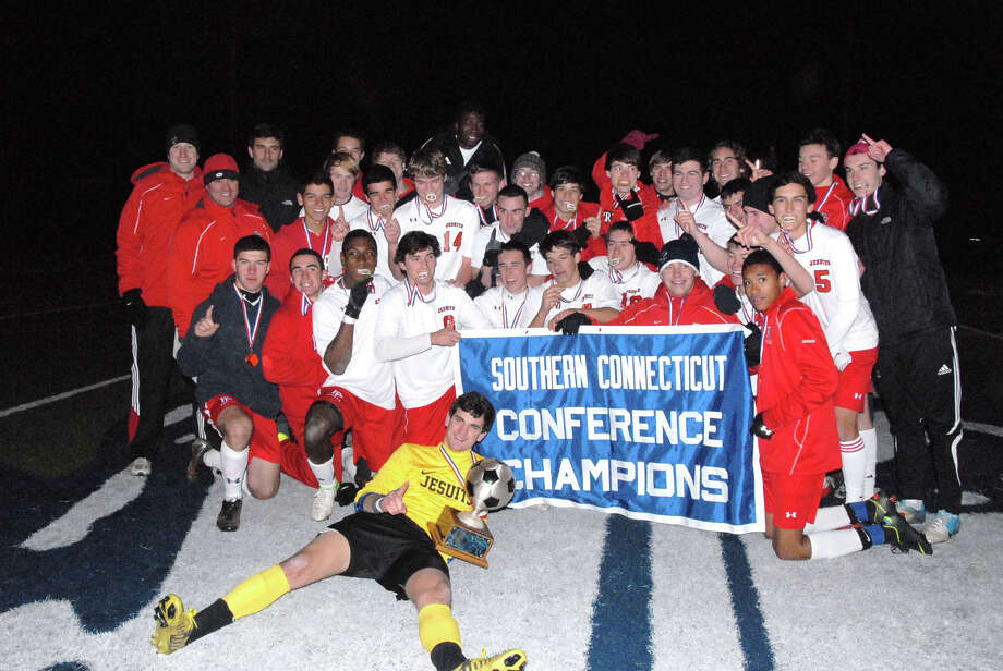 Fairfield Prep's boys soccer team celebrates its second consecutive SCC Championship on Tuesday night in West Haven. Photo: Contributed Photo
