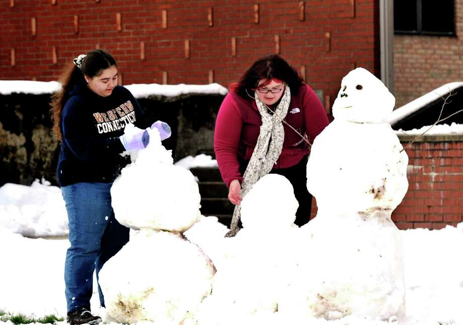 Western Connecticut State University freshmen Sarah Chavin of New Milford, left, and Sarah Bojnec of Torrington, build the first snowman of the season on the university's midtown campus Thursday, Nov. 8, 2012. Photo: Michael Duffy / The News-Times