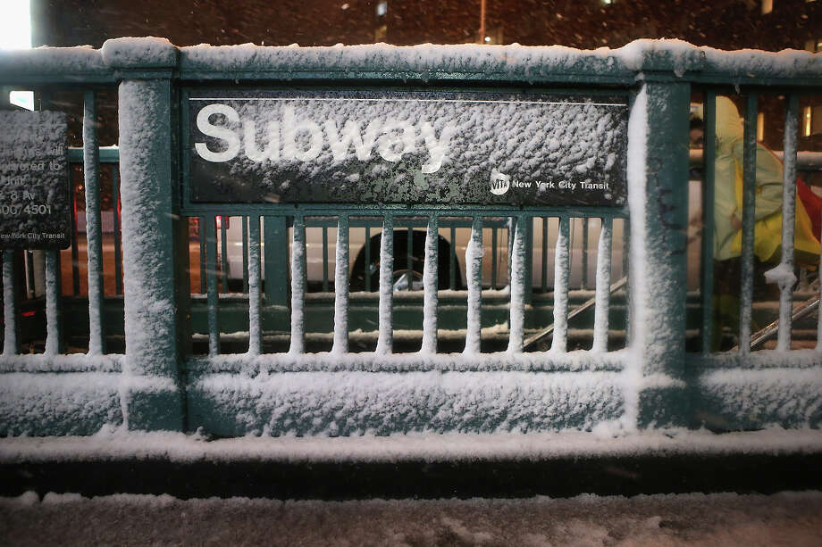 NEW YORK, NY - NOVEMBER 07:  A subway stop stands snow-covered at Union Square on November 7, 2012 in New York City. The city was hit by a Nor'Easter storm, just ten days after Superstorm Sandy ravaged the tri-state area. Photo: John Moore, Getty Images / 2012 Getty Images