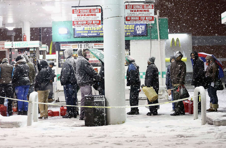 NEW YORK, NY - NOVEMBER 07:  People wait on line to buy gasoline during a Nor'Easter snowstorm on November 7, 2012 in the Brooklyn borough of New York City. The city is still experiencing long gas lines in the wake of Superstorm Sandy. Photo: Mario Tama, Getty Images / 2012 Getty Images
