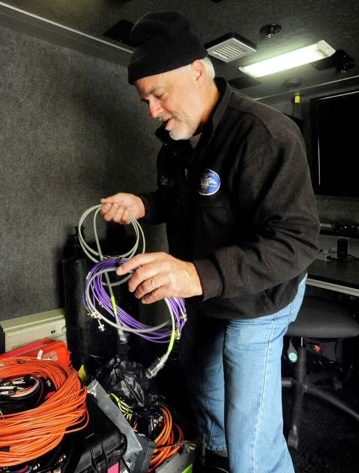 Marty Carver of the Weather Channel coils cables after broadcasting from the CityCenter Green in Danbury in Thursday's snow Thursday, Nov. 8, 2012. Photo: Michael Duffy / The News-Times