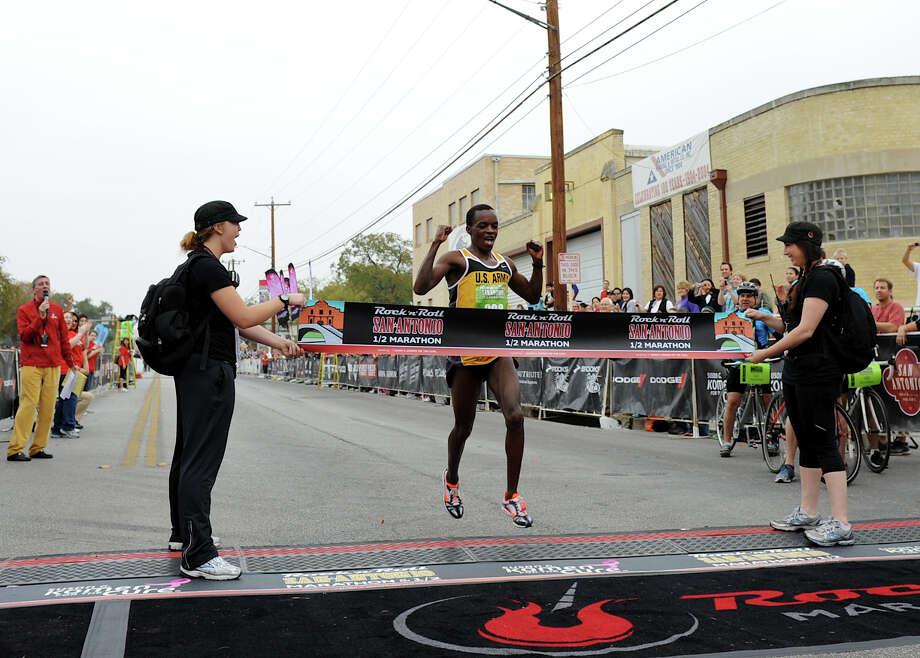 Half Marathon (Men) 11/13/11 - Augustus Mayo: 1:04:24 Photo: JOHN ALBRIGHT, Express-News / San Antonio Express-News