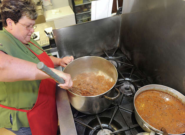 Martha Vautrot stirs a pot of gumbo in the kitchen at Vautrot's restaurant on Highway 105. Vautrot said cooking the meat in the gumbo helps add to the flavor.  Photo taken Wednesday, October 31, 2012 Guiseppe Barranco/The Enterprise Photo: Guiseppe Barranco, STAFF PHOTOGRAPHER / The Beaumont Enterprise