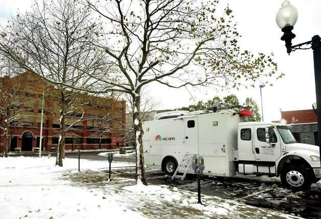The Weather Channel broadcasts from the CityCenter Green in Danbury in Thursday's snow, Nov. 8, 2012. Photo: Michael Duffy / The News-Times