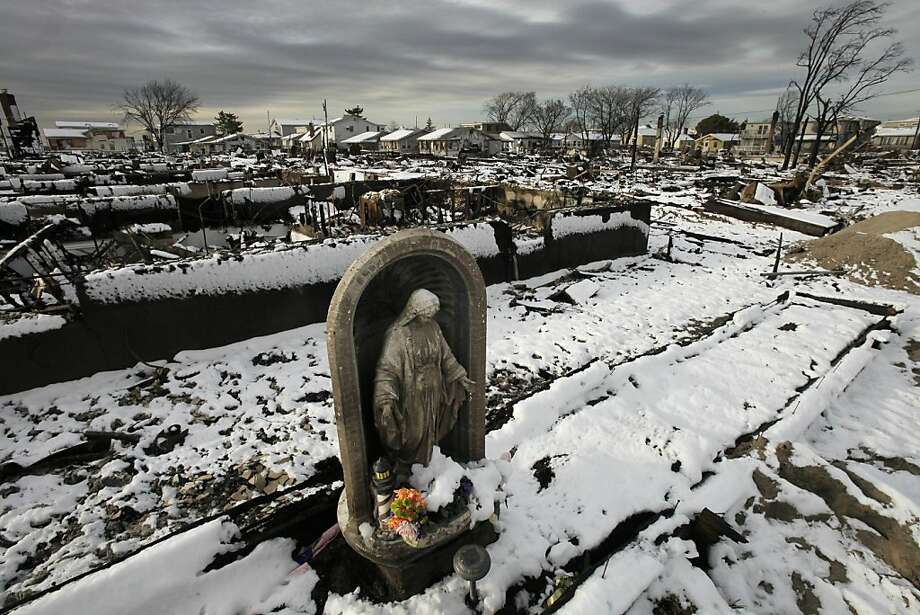 A religious statue stands in the fire-scorched landscape of Breezy Point after a Nor'easter snow, Thursday, Nov. 8, 2012 in New York.  The beachfront neighborhood was devastated during Superstorm Sandy when a fire pushed by the raging winds destroyed many homes. Photo: Mark Lennihan, Associated Press