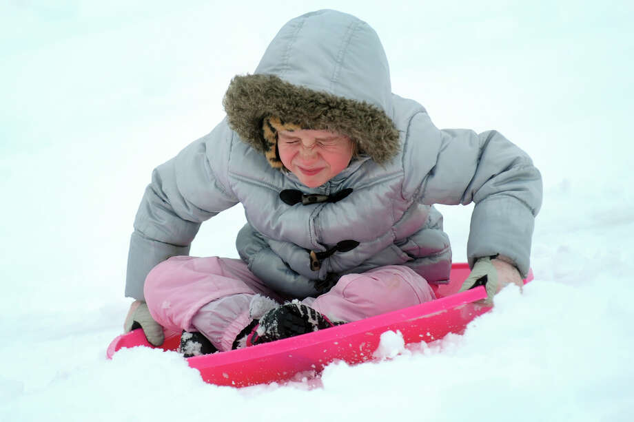 Jocelyn Ciotti, 7, sleds down a hill next to Flood Middle School, in Stratford, Conn., Nov. 8th, 2012. Photo: Ned Gerard / Connecticut Post