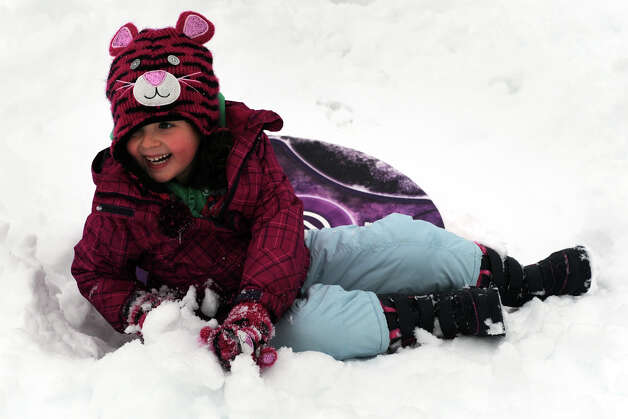 Lilly Farrell, 5, sleds down a hill next to Flood Middle School, in Stratford, Conn., Nov. 8th, 2012. Photo: Ned Gerard / Connecticut Post