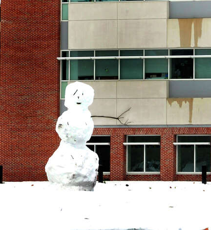 A one-arm snowman stands outside Western Connecticut State University's midtown campus Thursday, Nov. 8, 2012. Photo: Michael Duffy / The News-Times