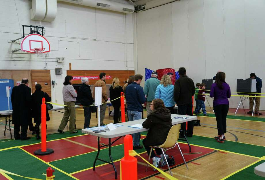 Voters at the Long Lots Elementary School polling station on Tuesday. Westport posted an 83 percent turnout rate in this year's election. Photo: Paul Schott / Westport News