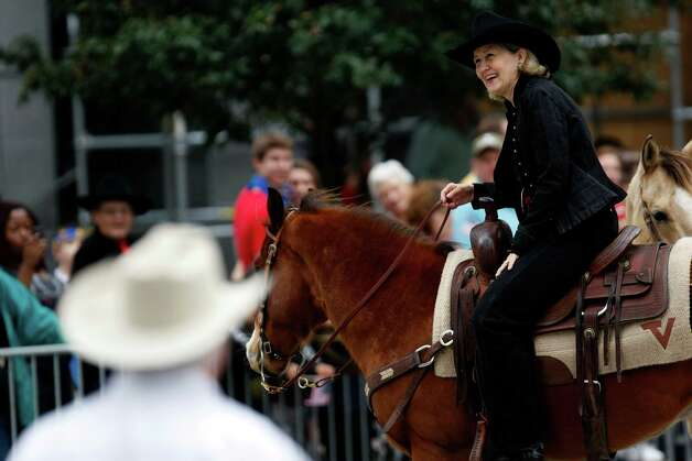 Sen. Kay Bailey Hutchison joined thousands of trail riders and committee members in the 2011 Livestock Show and Rodeo Parade downtown Saturday, Feb. 26, 2011, in Houston. Photo: Johnny Hanson, Houston Chronicle / Houston Chronicle