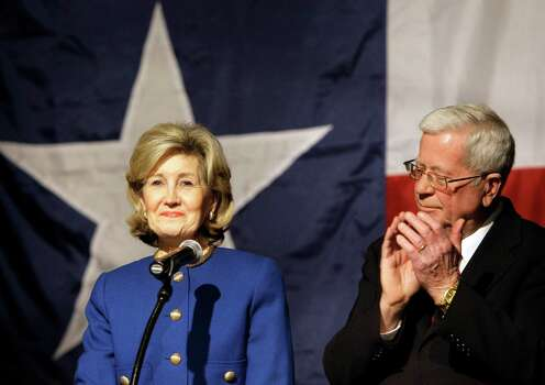 Sen. Kay Bailey Hutchison smiles as she acknowledges support from her husband Ray and others following her speech conceding from the Republican nomination for Texas governor in Dallas on Tuesday, March 2, 2010. Photo: Tony Gutierrez, AP / AP