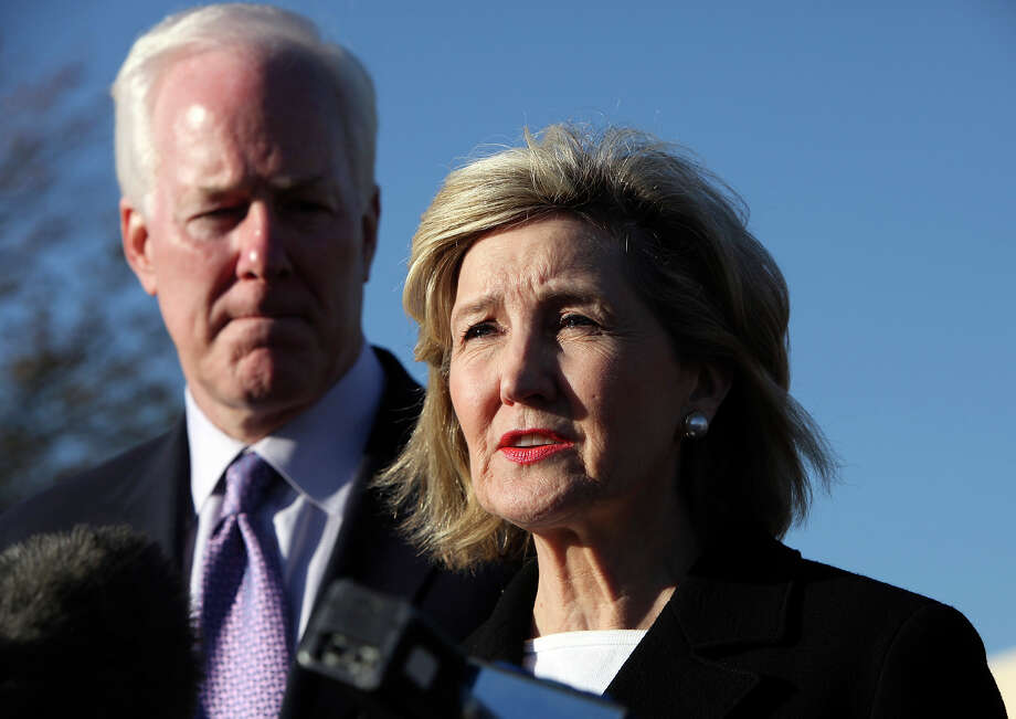 Senator John Cornyn listens to Senator Kay Bailey Hutchison speak during a press conference outside III Corps headquarters Friday Nov. 6, 2009 on Fort Hood Army Base in Fort Hood, Tx. Photo: EDWARD A. ORNELAS, San Antonio Express-News / San Antonio Express-News