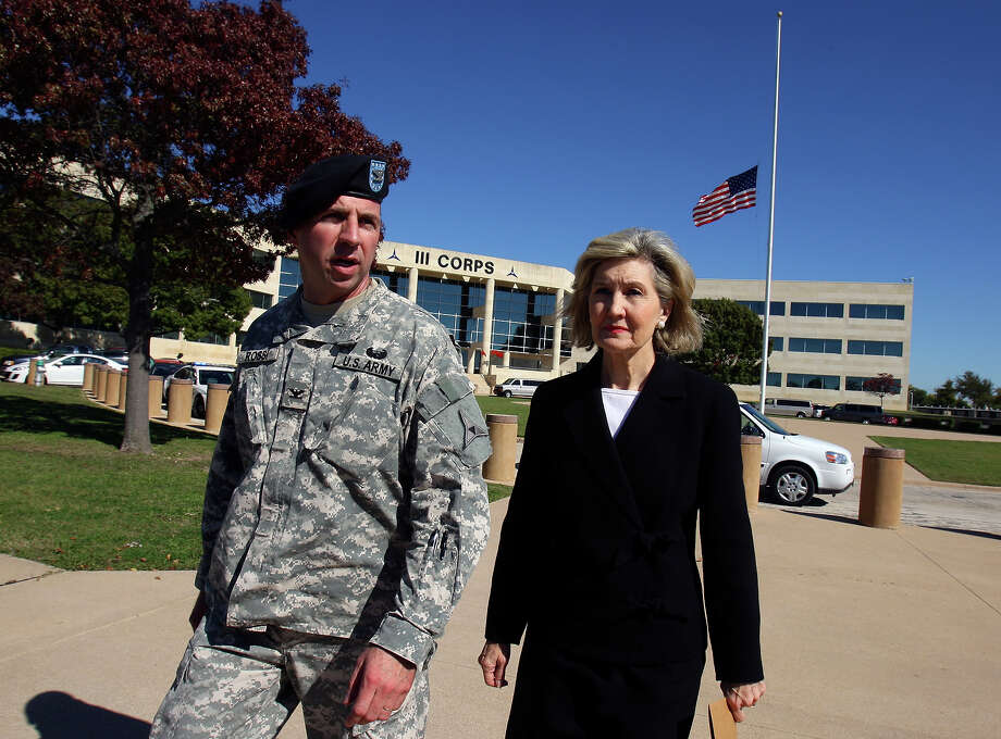 U.S. Army Col. John Rossi and Senator Kay Bailey Hutchison walk past III Corps headquarters where an American flag flies at half-staff Friday Nov. 6, 2009 on Fort Hood Army Base in Fort Hood, Tx. Photo: EDWARD A. ORNELAS, San Antonio Express-News / San Antonio Express-News