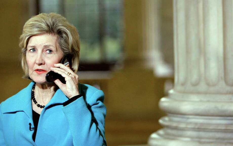 Sen. Kay Bailey Hutchison talks on the phone about the shooting at Fort Hood, Texas, on Capitol Hill in Washington Thursday, Nov. 5, 2009. Photo: Alex Brandon, AP / AP