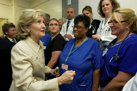 Keep on doing good work, Sen. Kay Bailey Hutchison said to nurses Frances Dib and Joaquina Simmons as she talked to a group of employees at Ben Taub General Hospital after a press conference on health care reform Monday, July 27, 2009, in Houston. Photo: Johnny Hanson, Houston Chronicle / Houston Chronicle