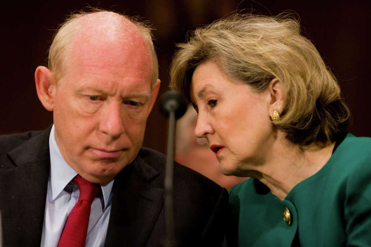 Sen. Kay Bailey Hutchison whispers to Bill White, mayor of Houston, while testifying on Capitol Hill about the Gulf Coast's recovery from Hurricanes Gustav and Ike on September 23, 2008 in Washington, D.C.