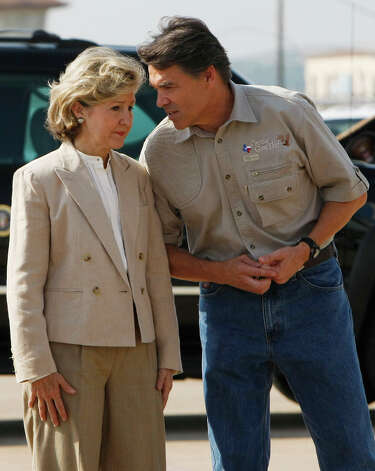 Texas Gov. Rick Perry talks to Sen. Kay Bailey Hutchinson as they wait to greet President Bush at Austin-Bergstrom International Airport in Austin, Texas on Sept. 1, 2008 Photo: Pablo Martinez Monsivais, AP / AP