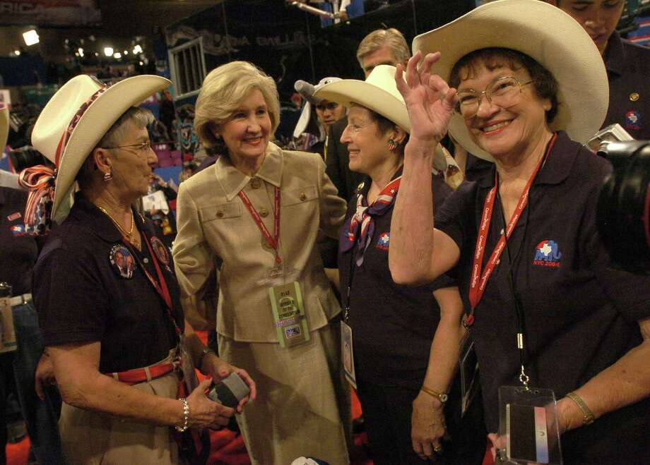 Dorothy Rogers, of Waxahachie, Sen. Kay Bailey Hutchison, Beverly Parks, of Granbury, and Dorothy Wiseman, of Hillsboro, chat with their matching outfits during the Republican Convention, at Madison Square Garden, in New York City, Tuesday, August 31, 2004. Photo: Karen Warren, Houston Chronicle / Houston Chronicle