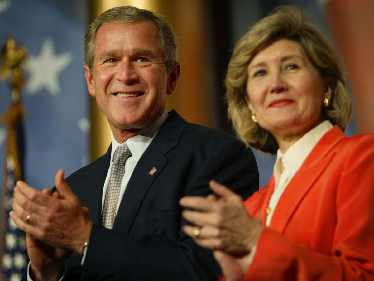 President Bush stands on stage with Sen. Kay Bailey Hutchison R-Texas during the introductions before he addresses the National Republican Senatorial Committee dinner at the National Building Museum Wednesday Sept., 25, 2002 in Washington, D.C.