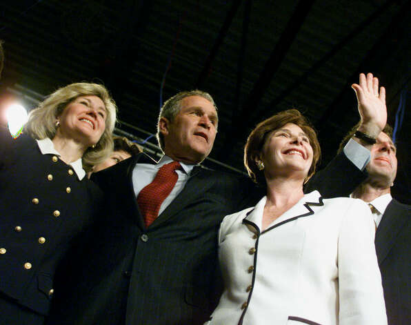 Texas Governor George W. Bush waves to his supporters with his wife Laura and Sen. Kay Bailey Hutchison by his side at the Dell Jewish Community Center in Austin, March 14, 2000. Photo: Kevin Fujii, Houston Chronicle / Houston Chronicle