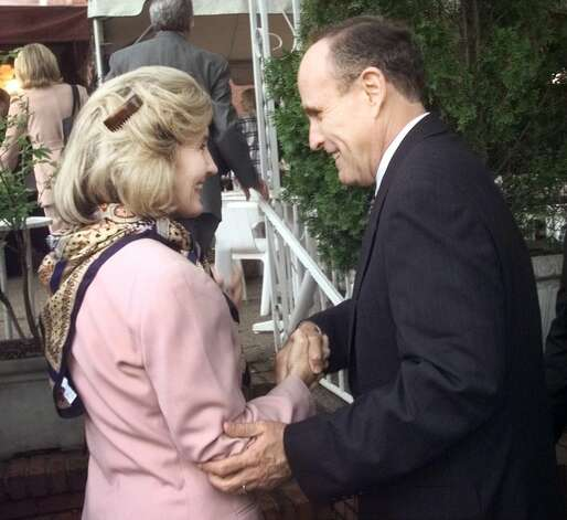 New York Mayor Rudolph Giuliani is greeted by Sen. Kay Bailey Hutchison as he walks to a restaurant on Capitol Hill Thursday, June 17, 1999. Photo: PABLO MARTINEZ MONSIVAIS, AP / AP