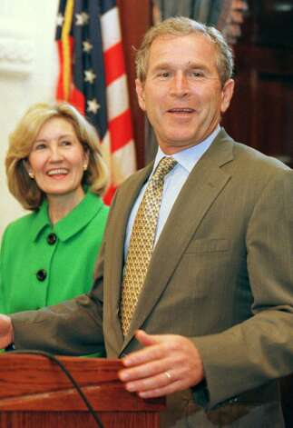 Texas Gov. George W. Bush speaks during a news conference on Friday, May 21, 1999, in Austin, Texas. At left is U.S. Sen. Kay Bailey Hutchison. Photo: HARRY CABLUCK, AP / AP