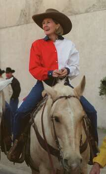 Texas Senator Kay Bailey Hutchison rides a horse named Elvis in the Houston Livestock Show and Rodeo Parade on Feb. 13, 1999. Photo: Melissa Phillip, Houston Chronicle / Houston Chronicle