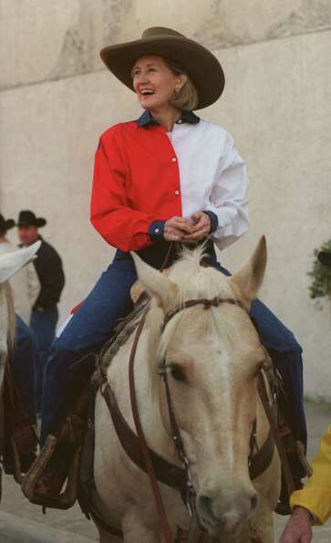 Texas Senator Kay Bailey Hutchison rides a horse named Elvis in the Houston Livestock Show and Rodeo