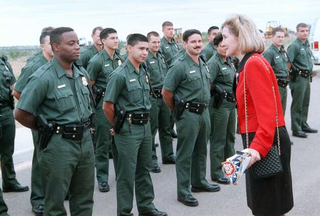 Sen. Kay Bailey Hutchison greets U.S. Border Patrol agents-in-training Wednesday, Nov. 11, 1998, prior to a groundbreaking ceremony for a new Border Patrol headquarters in Laredo, Texas. Photo: J. MICHAEL SHORT, AP / LAREDO MORNING TIMES