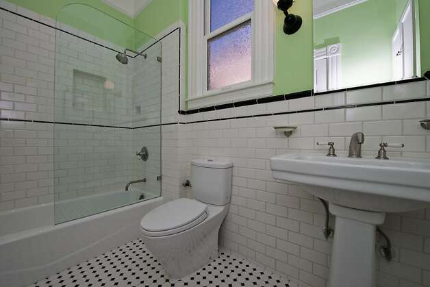 There are two full bathrooms in the home, plus a powder room on the main level. Photo: Devin MacDonald, Tppsf.com