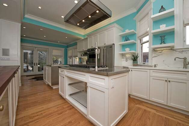 The updated kitchen features honed marble counters and modern appliances, including a Viking convection oven and six-burner range and Jenn-Air refrigerator. Photo: Devin MacDonald, Tppsf.com