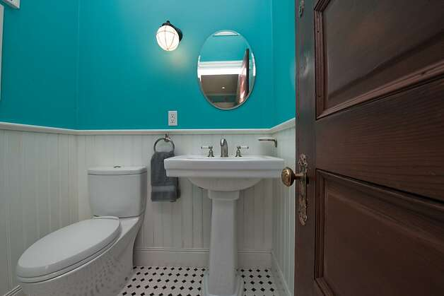 The powder room is situated on the main living level. Photo: Devin MacDonald, Tppsf.com