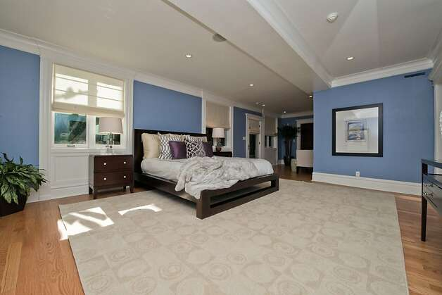 Downstairs, the master bedroom features a sitting area, office nook and a large walk-in closet. Photo: Devin MacDonald, Tppsf.com
