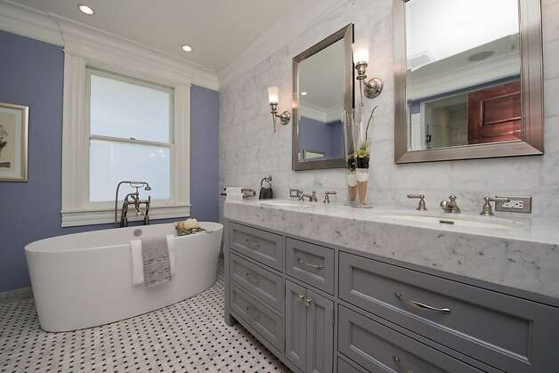 The master suite's bathroom features a Victoria + Albert soaking tub. Photo: Devin MacDonald, Tppsf.com