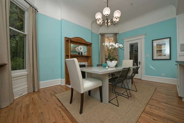 The dining area features a built-in sideboard. Photo: Devin MacDonald