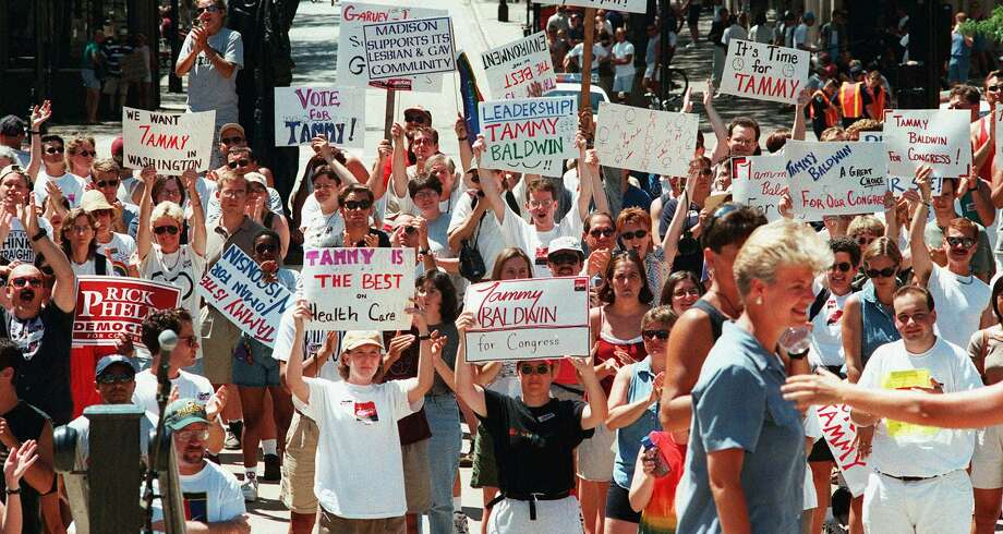 Allows limited domestic partnership: WisconsinNewly-elected Wisconsin Sen. Tammy Baldwin, bottom right, who was a state representative when this photo was taken, drew cheers at a rally prior to an annual Gay Pride Parade in Madison, Wis.,  Sunday, July 19, 1998. Baldwin made history Tuesday when she became the first openly-gay politician to be elected to the U.S. Senate. She's also the first female Wisconsin senator.  Photo: CRAIG SCHREINER, AP / WISCONSIN STATE JOURNAL