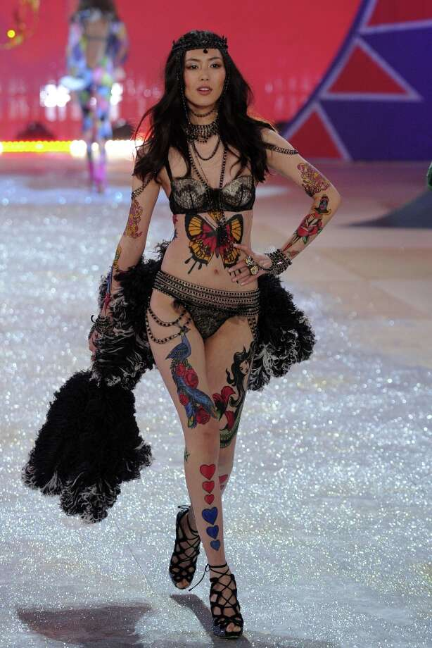 Model Liu Wen walks the runway during the Victoria's Secret 2012 Fashion Show on November 7, 2012 in New York City.  (Photo by Bryan Bedder/Getty Images for SWAROVSKI ELEMENTS) Photo: Bryan Bedder, Getty Images For SWAROVSKI ELEME / 2012 Getty Images