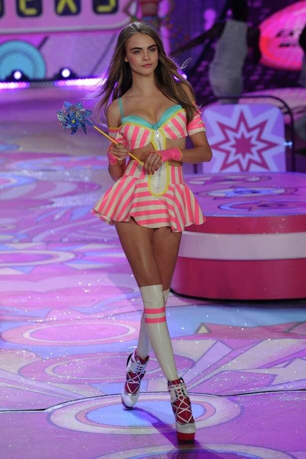 Model Cara Delevingne  walks the runway during the Victoria's Secret 2012 Fashion Show on November 7, 2012 in New York City.  (Photo by Bryan Bedder/Getty Images for SWAROVSKI ELEMENTS) Photo: Bryan Bedder, Getty Images For SWAROVSKI ELEME / 2012 Getty Images