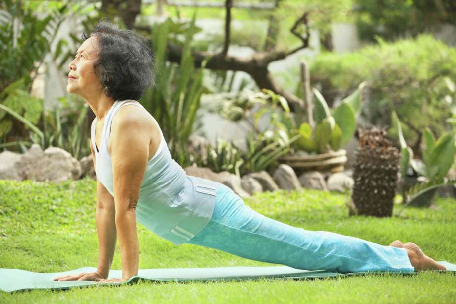GAIN FLEXIBILITY: Many wellness programs and senior living facilities have turned toward yoga, the ancient Hindu practice of uniting mind, body and spirit. Photo: Rudyanto Wijaya / iStockphoto
