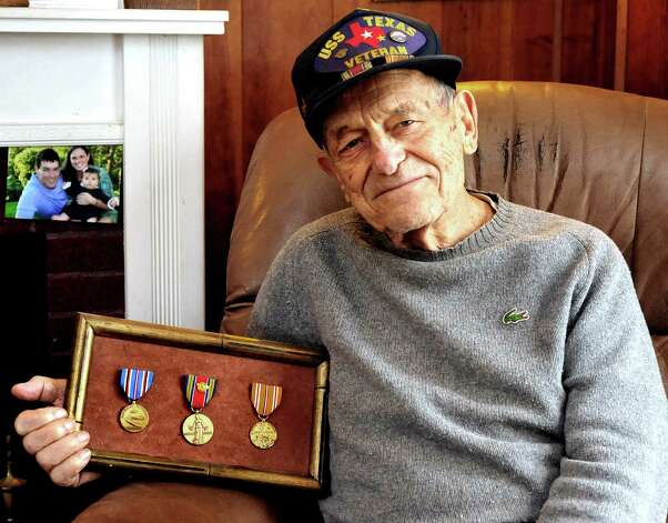Mike Scepanski, 93, holds his medals from the U.S. Navy in his Danbury home Thursday, Nov. 8, 2012. Photo: Michael Duffy / The News-Times