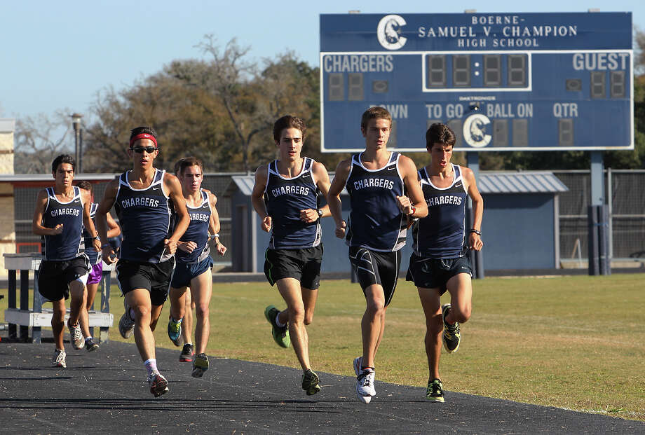 The Boerne Champion High School varsity boys cross country team work out on Thursday, Nov. 8, 2012. The team will be competing for another state title to add to their wins from 2008, 2009 and 2011. Both the girls and boys teams qualified for the state meet. Photo: Kin Man Hui, San Antonio Express-News / ©2012 San Antonio Express-News