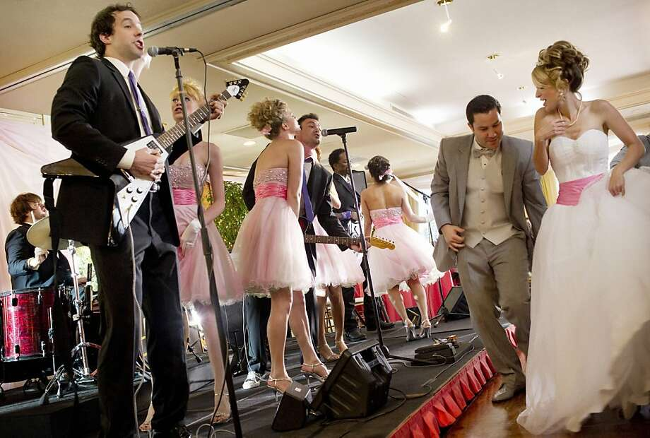"Peter Cambor (left) plays Eddie, a married guy with kids, in the new TBS comedy ""Wedding Band."" Photo: Darren Michaels, TNT"