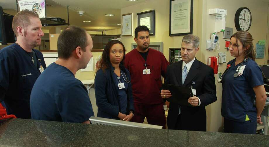 West Houston Medical Center CEO Todd Caliva, second from right, checks in with staff members in the emergency department. From left are Bubba Alford, Ken Wall, IJ Okoro, Mario Lopez and Stephanie Ross. Photo: Gary Fountain, Freelance / Copyright 2012 Gary Fountain.