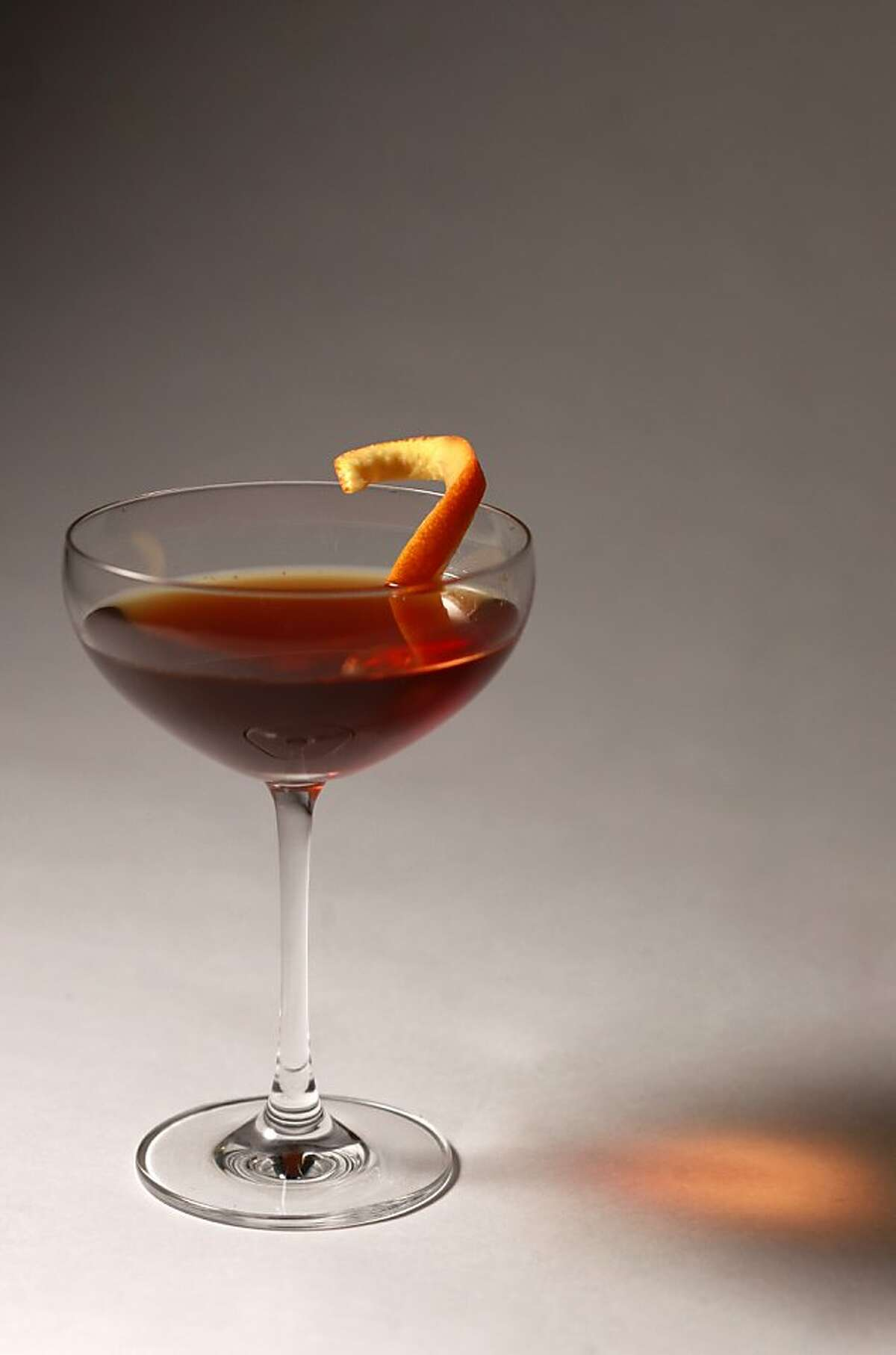 2. Classic Manhattan - 2 1/2 oz. rye whiskey (bourbon can substitute) - 3/4 oz. sweet vermouth - dash of Angostura bitters - 1 maraschino cherry (or lemon or orange peel as garnish) Pour the bourbon and sweet vermouth in a cocktail shaker with ice. Add a dash of bitters. Stir or shake (your preference), then strain it all out into a martini glass. Add the maraschino cherry and sip away. Try soaking dried cherries in whiskey and leaving them in the fridge for a garnish. Or use lemon peel. Many other brands and flavors of bitters are available for different flavor profiles.
