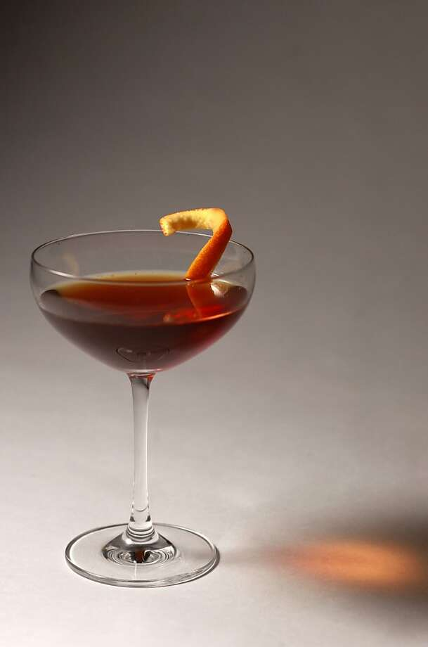2. Classic Manhattan - 2 1/2 oz. rye whiskey (bourbon can substitute) - 3/4 oz. sweet vermouth - dash of Angostura bitters - 1 maraschino cherry (or lemon or orange peel as garnish) Pour the bourbon and sweet vermouth in a cocktail shaker with ice. Add a dash of bitters. Stir or shake (your preference), then strain it all out into a martini glass. Add the maraschino cherry and sip away. Try soaking dried cherries in whiskey and leaving them in the fridge for a garnish. Or use lemon peel. Many other brands and flavors of bitters are available for different flavor profiles.  Photo: Craig Lee, Special To The Chronicle