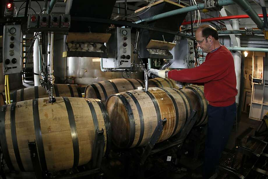 Steve Leauhman, a Jim Beam Brands Co. employee, fills white oak barrels with bourbon at the distillery in Clermont, Ky. Jim Beam is big and trendy in Russia. Photo: John Sommers II, Bloomberg