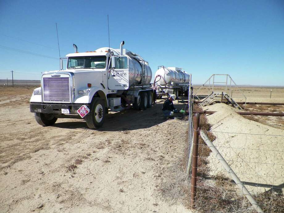 Plains All American Pipeline Driver Casey Moutray is preparing to load a crude oil production lease north of Wamsutter Wyoming. Plains All American Pipeline was named to the Chronicle's list of Top Workplaces.