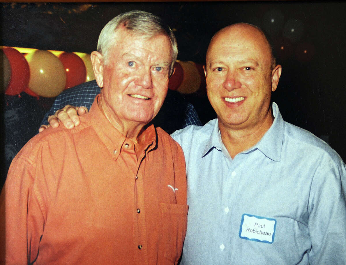 Former Texas football player Paul Robichau, left, with famed Texas coach Darrell Royal in a 2000 photo taken at a reunion at the University of Texas. Royal died Wednesday. Robichau said Royal was a quick witted coach who remembered all of his players. Photo taken Wednesday, November 07, 2012 Guiseppe Barranco/The Enterprise