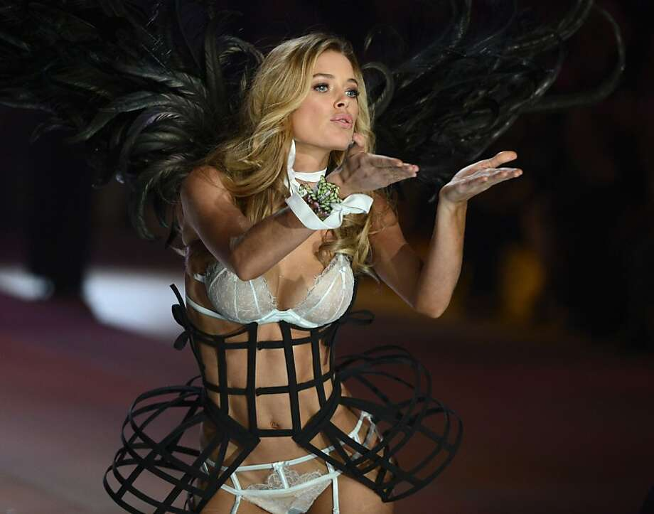 Glad Victoria's Secret added the waist bird cages,because lingerie on a winged supermodel just isn't sexy enough. (Victoria's Secret Fashion Show, New York.) Photo: Timothy A. Clary, AFP/Getty Images